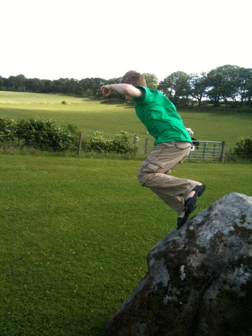 Ian jumping off rock